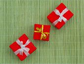 Three gift boxes on bamboo