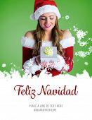pretty girl in santa costume holding gift box against feliz navidad