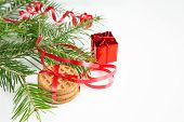 Christmas Tree Branch, Cookies And Red Decoration