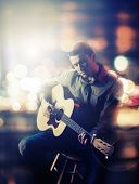 stock photo of guitar  - Guitarist playing acoustic guitar - JPG