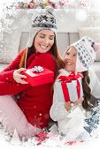 Mother and daughter exchanging gifts at christmas against christmas theme frame in silver