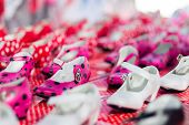stock photo of shoe-box  - Typical spanish gipsy shoes on their boxes. Shallow depth of field. ** Note: Shallow depth of field - JPG