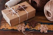 Brown crochet snowflakes for Christmas decoration of gift box