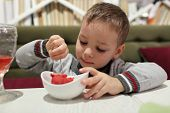 Boy Eating Fruit Ice Cream
