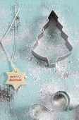Merry Christmas Festive Baking Concept With Cookie Cutters On Pale Aqua Blue Vintage Style Recycled