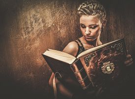 stock photo of gothic girl  - Steampunk girl with a book - JPG