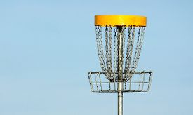picture of frisbee  - Frisbee golf basket against blue summer sky - JPG