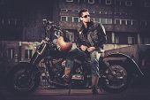 picture of ape-man  - Biker and his bobber style motorcycle on a city streets  - JPG