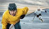 pic of ice hockey goal  - Ice hockey player on the ice in mountains - JPG