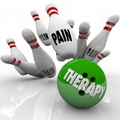 picture of medical condition  - Therapy word on a bowling ball striking pins marked Pain to illustrate curing or preventing symptoms of injury - JPG