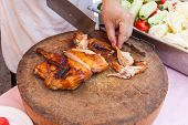 image of chef knife  - Chef are using Kitchen knife chicken grilled on wood block  - JPG
