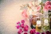foto of mulberry  - Bottles with basics oils for spa on mulberry paper texture vintage style - JPG