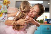 image of hug  - Daughter Hugging Mother Returning From Work - JPG