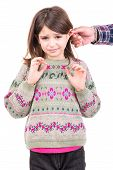 stock photo of punishment  - Young girl being punished with ear pulling - JPG