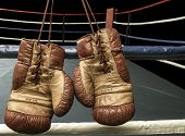 stock photo of boxing ring  - Vintage boxing gloves hanging on boxing ring tropes - JPG