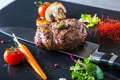 pic of porterhouse steak  - Grilled Beef steak with vegetable decoration - JPG