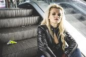 picture of swag  - Urban beautiful blonde with a baseball bat in escalators - JPG