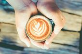 stock photo of latte coffee  - man holding hot cup of coffee latte art coffee lover concept - JPG