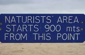 stock photo of naturist  - naturist beach sign in studland bay poole dorset uk - JPG
