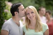 picture of heterosexual couple  - Portrait of a happy young heterosexual couple looking at camera - JPG