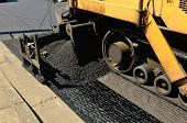 picture of paving  - A paver finisher asphalt finisher or paving machine placing a layer of asphalt during a repaving construction project - JPG