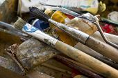picture of differential  - Painting brushes in a splattered artist box differential focus horizontal shot - JPG