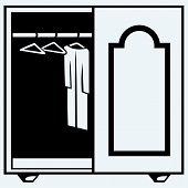 stock photo of wardrobe  - Wardrobe with clothes - JPG