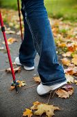 Nordic Walking Race On Autumn Trail
