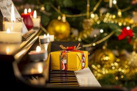 foto of ribbon decoration  - Christmas gift on piano - JPG