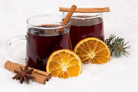 image of alcoholic drinks  - Mulled wine drinking on Christmas in winter alcohol drink in snow - JPG
