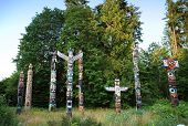 picture of indian totem pole  - Indian painted totem poles in Stanley Park - JPG