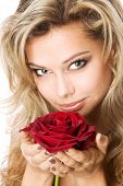 Young blond holding a red rose