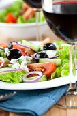 stock photo of gout  - Greek salad and red wine - JPG