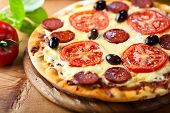 Rustic stone backed pizza with chorizo salami