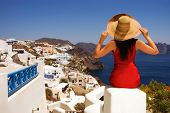 Beautiful young Greek woman on the streets of Oia, Santorini, Greece.