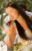Young Beautiful woman tasting red wine at restaurant (shallow dof)