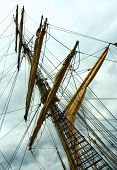 Dockside of old sailing ship at sunset.