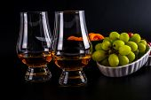 Single Malt Tasting Glasses, Single Malt Whisky In A Glass, White And Red Grapes In White Bowls poster