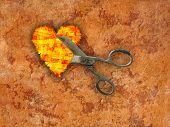 Heart & scissors on rusty background