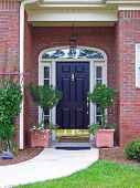 stock photo of front door  - a beautiful southern carolina outside front porch - JPG