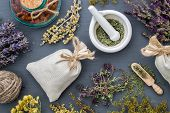 Medicinal Herbs, Mortar Of Healing Herbs, Sachet And Bottle Of Healthy Drugs On Wooden Table. Herbal poster
