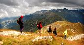 Tatra Mountains stormy landscape panorama and hikers walking