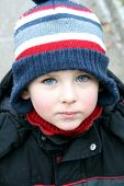 Winter child with beautiful blue eyes