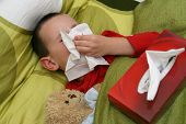 Ill child with catarrh and tissue