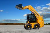 skid steer loader construction machine with bucket outdoors