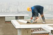 construction works with circular abrasive cutoff saw angle grinding machine and sparkles