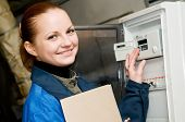 foto of pressure vessel  - cheerful woman engineer checking technical data of heating system equipment in a boiler room - JPG