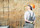 one builder worker in work wear and hardhat at construction site