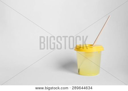 Paint Brush In Cup Of