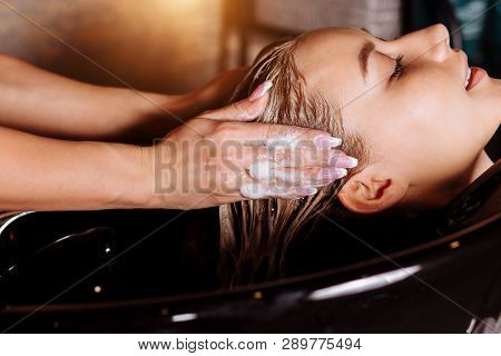 poster of Beautiful Woman Washing Hair In A Hair Salon